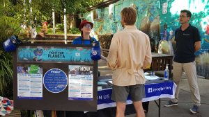 Sasha and Sebastian out on the street helping people understand the actions they can take to reduce emissions.